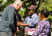 Pat is presented with a tais at a ceremony to open a new water system.