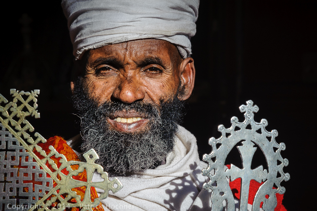 Priest and his crosses, Lalibela, Ethiopia