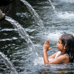 Purification at the Tirta Empul Temple, Bali