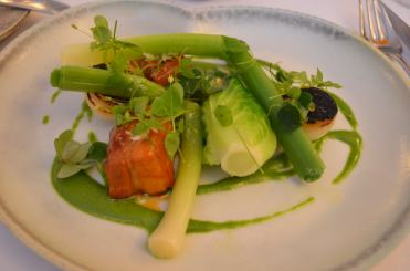 Pork belly with baby cabbage, asparagus, and charred onion..