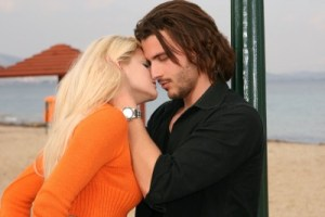 blonde woman kissing man 2616594_s