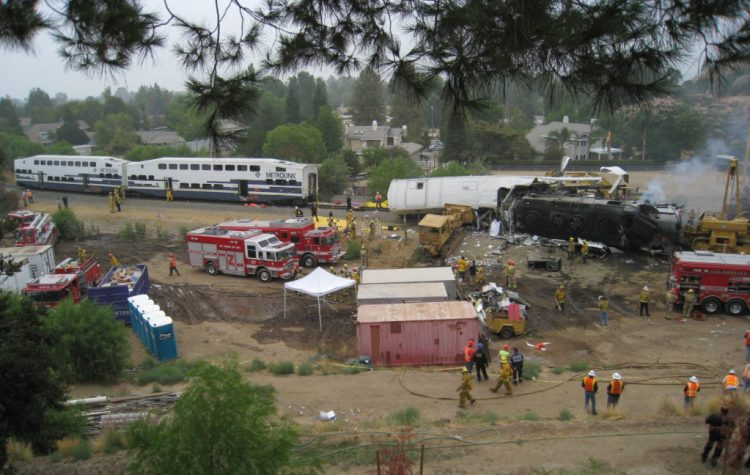 Wide shot of crash scene with emergency workers