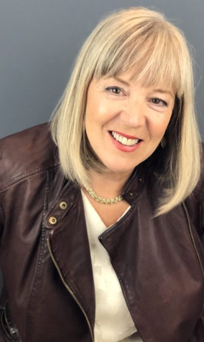Photo of Patricia Simpson in a leather jacket.