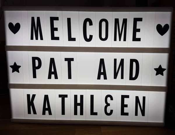 Sign reading MELCOME PAT AND KATHLEEN