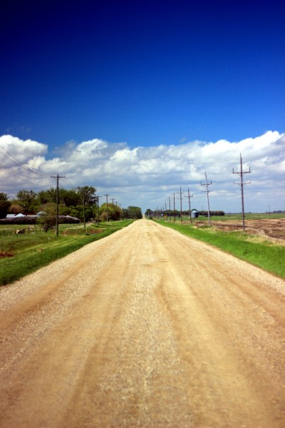 Country road and prairie sky
