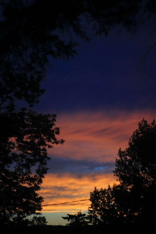 Sunset with clouds: blue, orange, pink, and indigo