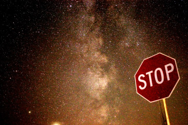 The Milky Way behind a stop sign