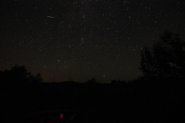 Long shot of a meteor burning up in the sky