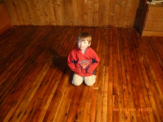 Noah enjoying a redone cabin floor.