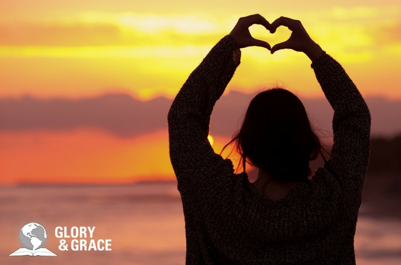 the Spirit's great work in our hearts showing a woman making a heart with her fingers