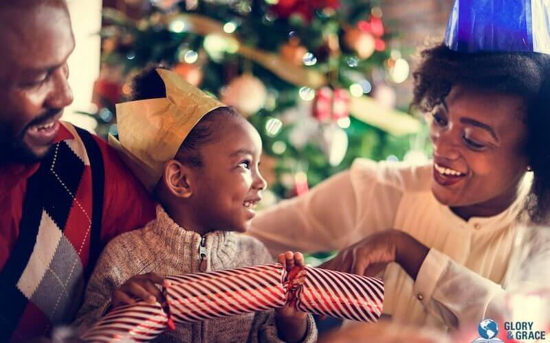Christmas bible verses image showing a happy family