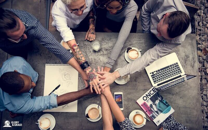 Unity of the Spirit image showing many people holding hands together