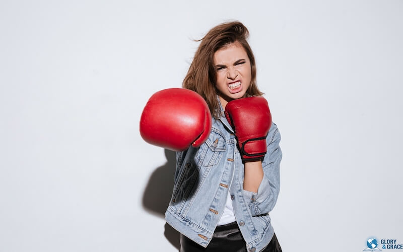 The violent taketh it by force showing an image of a female boxer