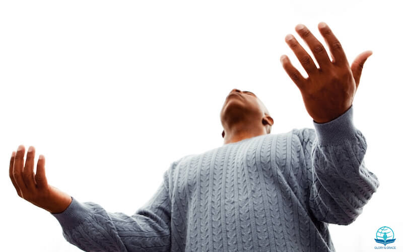 I will bless the Lord at all times image showing a man with lifted hands