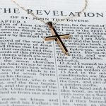 Revelation of the Savior image showing the book of revelation and the cross
