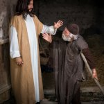 Divine healing showing Jesus praying for a man