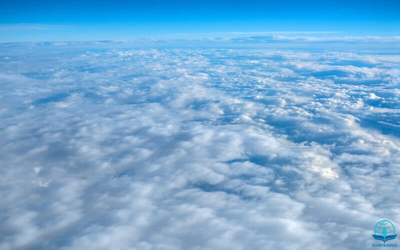 Who is like the Lord image showing the skies with clouds