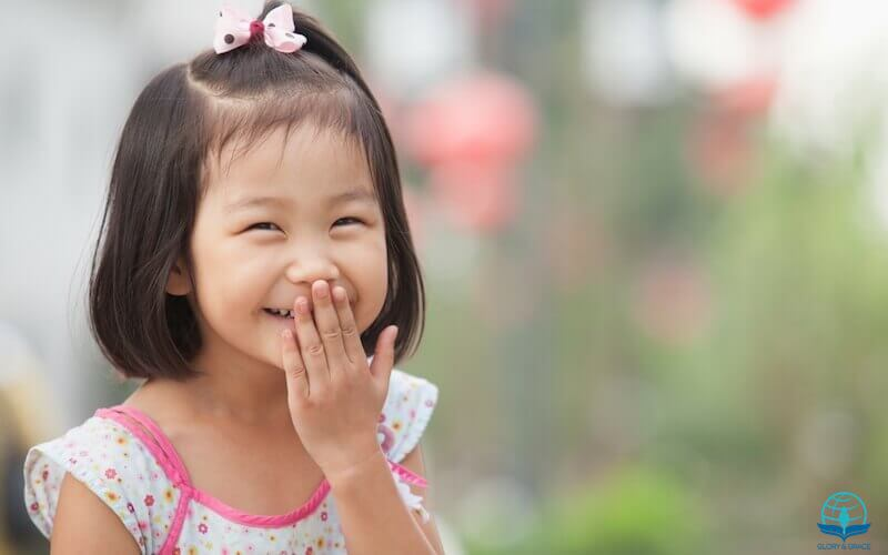 God laughs article showing a little asian girl laughing