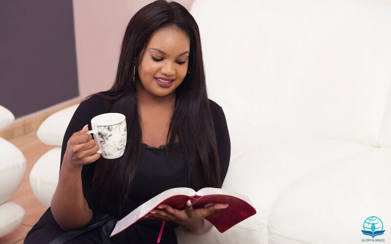 How love I Thy law image showing a woman enjoying the Bible