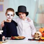 spirit of antichrist showing two kids celebrating halloween