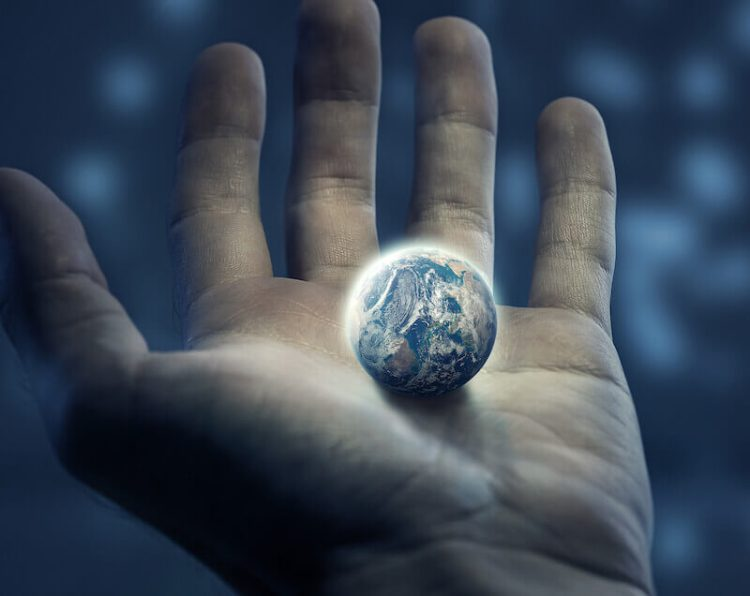 God working showing the earth in a man's hands