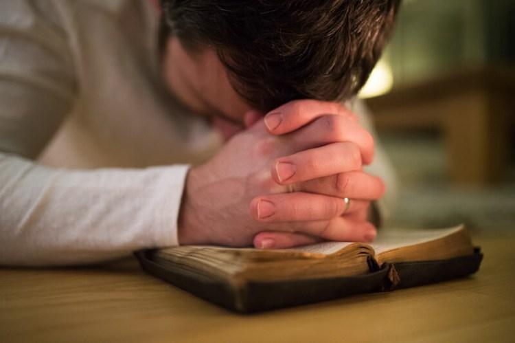 Devotional life showing a man praying