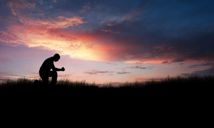 prayer of paul showing a man kneeling down