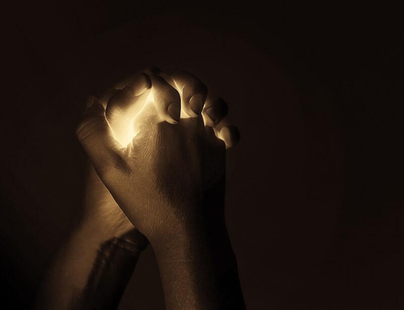 prayer showing a man's hand in prayer