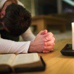 thy prayer is heard showing a man praying