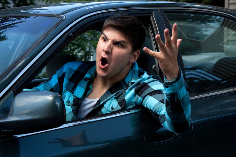 fool gives full vent to his anger showing a man on the road