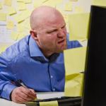 two kinds of understanding showing a man stressed up looking at a computer