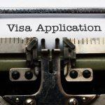 no more strangers showing a typewriter writing visa application