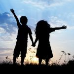 created to fellowship with God showing a young boy and girl holding hands