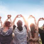 man believes with the heart showing a group of people making hearts with their fingers