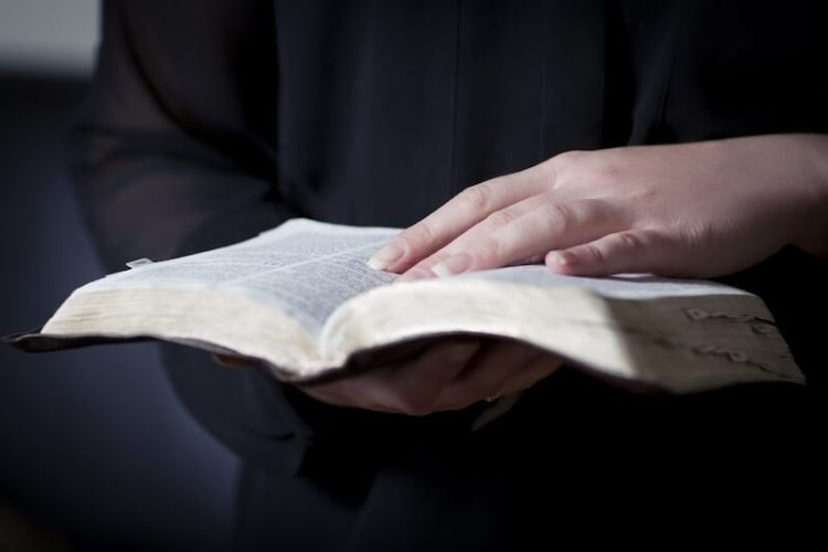 what is truth showing hands holding and opening the Bible