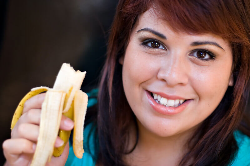 overcoming lust showing a woman eating a banana