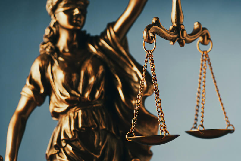 justified freely by his grace showing the a justice balance