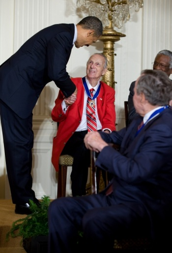 Stan Musial receives the Presidential Medal of Freedom as two other recipients -- Former President George H.W. Bush and basketball star and human-rights advocate Bill Russell -- look on.  (Official White House Photo by Pete Souza.)
