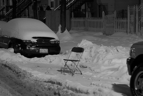 Lawn chairs in parking space