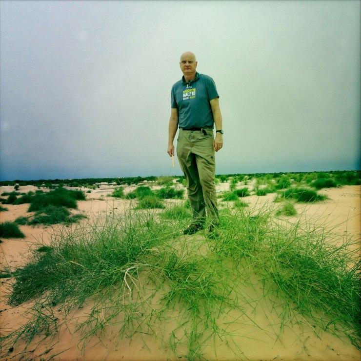 Patrick Symmes outside Timbuktu, Mali. Bonfire of the Humanities, Outside. Photographer Marco Di Lauro/Getty Reportage