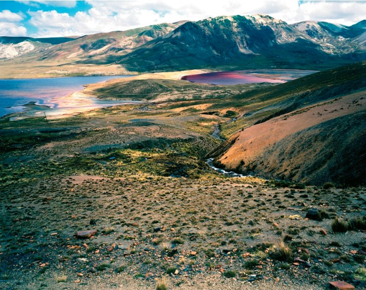 The Cordillera Real Mountains, just outside La Paz, surrounding Laguna Milluni -- the water gets its color from the runoff of a nearby mine. Photographs by Olaf Otto Becker