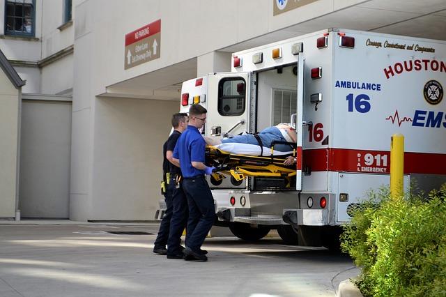 A couple of Houston EMS unloading a gurney