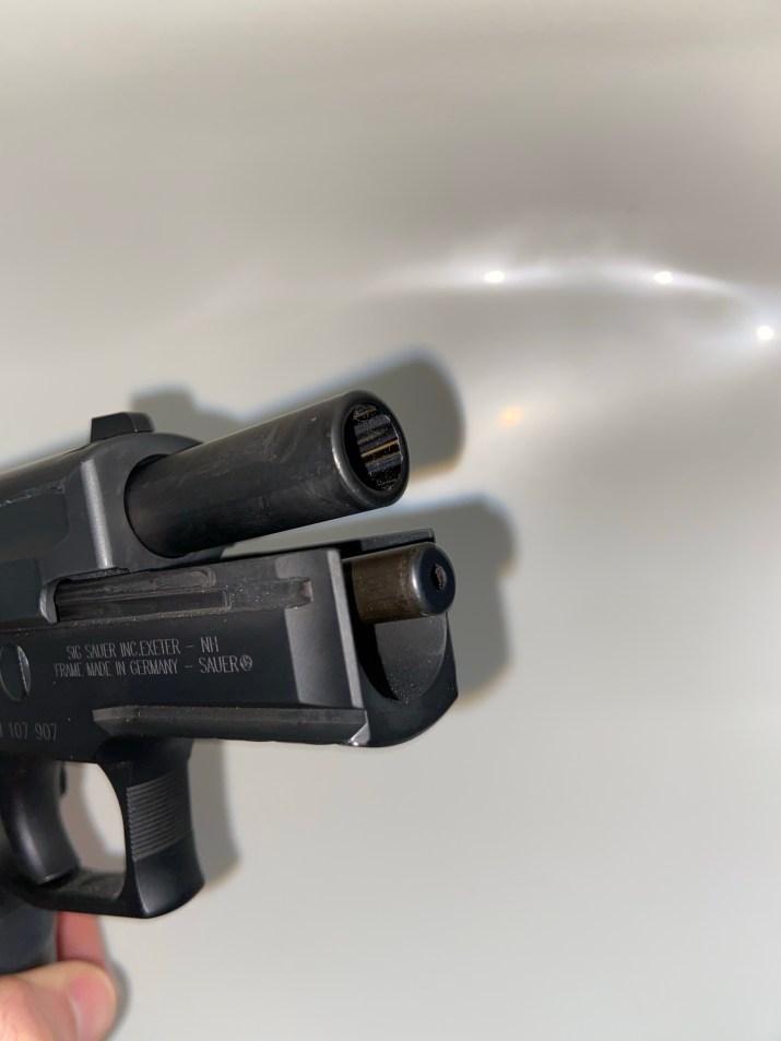 Slide back front view of barrel of SIG SAUER P229