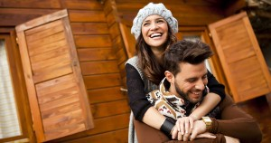 romantic couple spending time at cabin on valentine's day