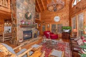 Living room with a large stone fireplace