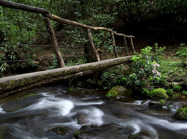 Water flowing under a bridge in the Smoky Mountains