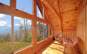 Sunroom with incredible mountain views at Looky Yonder - a Gatlinburg rental cabin
