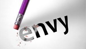 Eraser deleting the word Envy