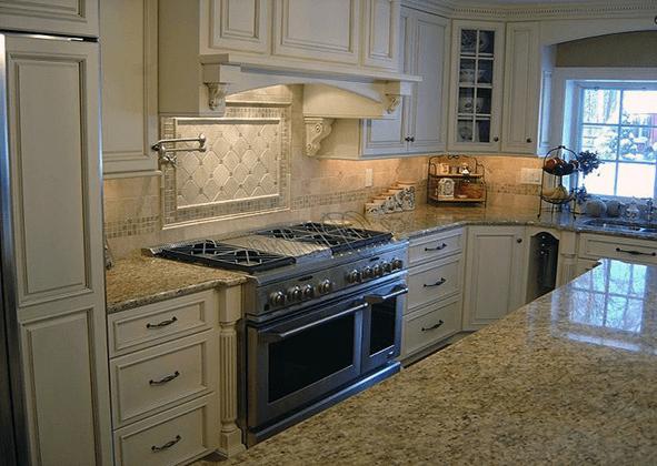 mid range kitchen cabinets countertop material new venetian gold granite