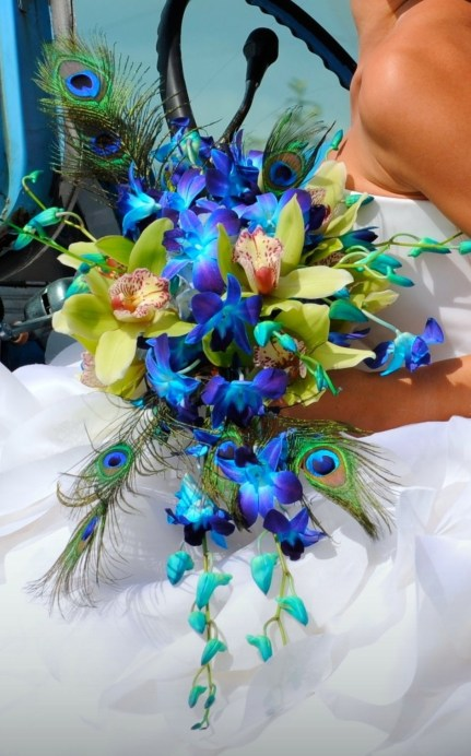 We will be seeing brides incorporating their themes within their flower choices, just like this peacock theme!